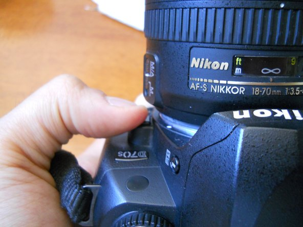 Image 2/2: Replace the lens with a lens cover.  This will keep dirt and tools from damaging the inside of the camera.