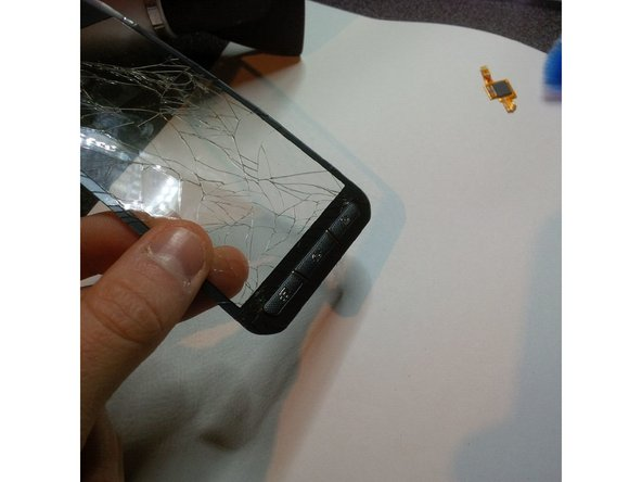 take the old broken digitizer and remove the plastic/rubber buttons., there is adhesive so you have to use the spudger to peel it off..
