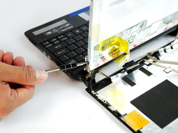 Image 2/2: Use the #0 Phillips Screw bit with the Screwdriver to remove the four 6mm Phillips screws from each side of the screen.