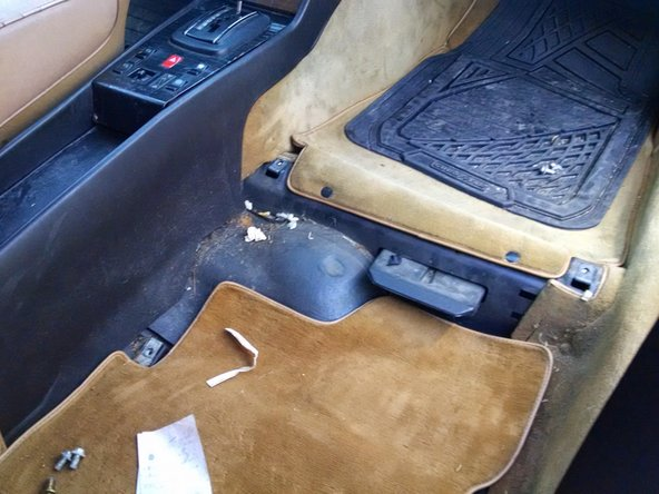While your seat is out, it's a great time to vacuum up potentially 30+ years of dirt and debris. This car was surprisingly clean underneath the seats. I didn't find many french fries and there were no ketchup packets at all. Though I did find about $1.00 in coins!