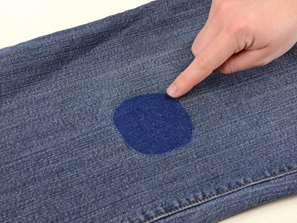 Run your finger around the edge of the patch to ensue that all the edges are completely bonded to your jeans.