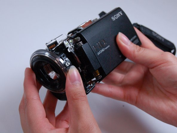 Carefully pull the lens cover and shutter assembly off of the front of the camera.