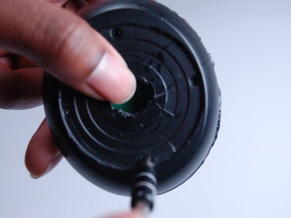 Image 1/3: Use a plastic opening tool to pry open the bottom of the stand.