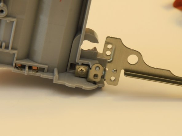 Remove the coarse thread screw from the top of the battery compartment.