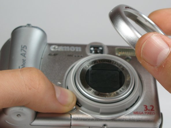 Twist the outer lens casing counter-clockwise and slide it out.