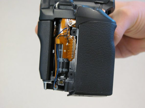 Slide panel toward bottom of camera to remove.