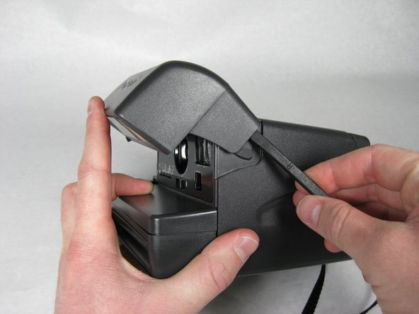 Separate the flash section of the camera from the main body by unhooking the sides with the spudger.