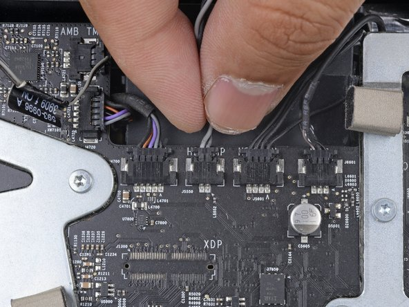 Find a connector on the motherboard labeled HD TMP or HDD TEMP.