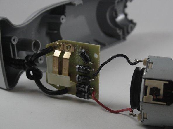 Remove 2 17.5 mm  Phillips PH#2 screws.