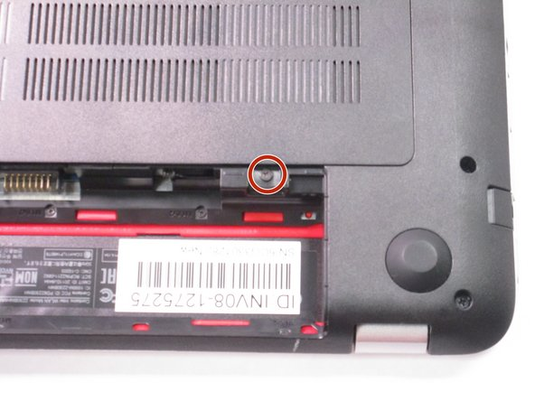 Remove the single screw holding the accessory plate.  This is a PH0 2.0x2.5 screw.