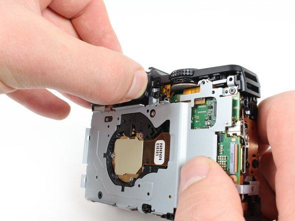 Image 1/2: Remove the rear viewfinder casing by firmly gripping it and pulling it out bottom first.