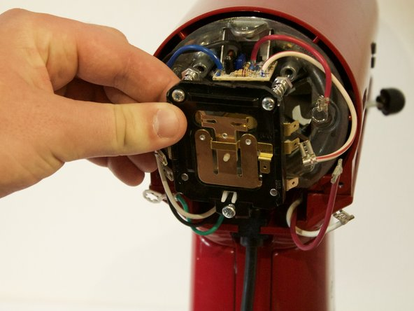 The control plate can now be removed by pulling back on the plate.