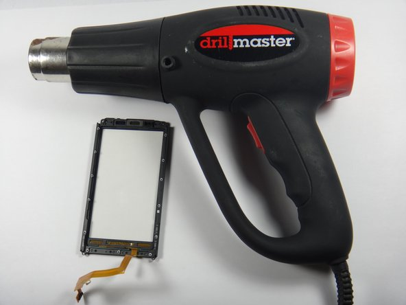 Using a heat gun, gently heat the edges of the screen