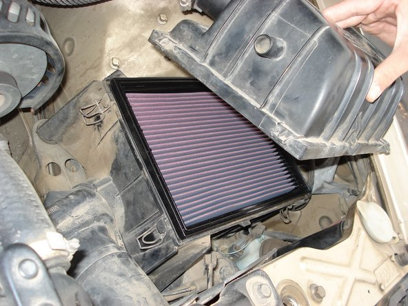 Image 2/2: Remove the air filter cover.