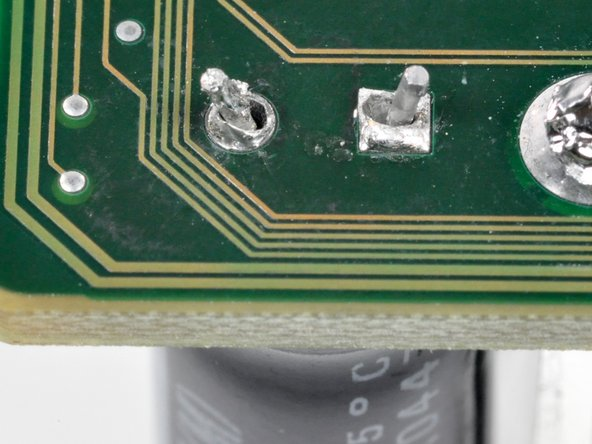 Image 1/1: To ease in soldering, slightly bend the contacts protruding through the holes so they hold themselves in place.