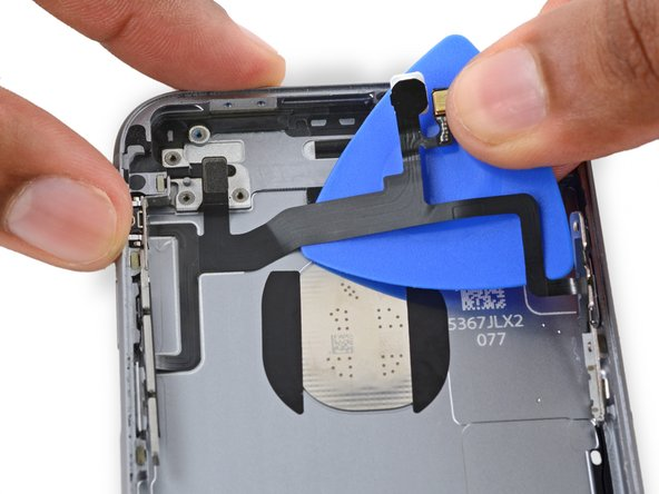 Continue pushing the opening pick under the cable until it fully separates from the rear case.