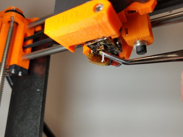 Heat the nozzle up. This step depends on what type of filament is currently in the machine (e.g. 190 for PLA, 220 for ABS).