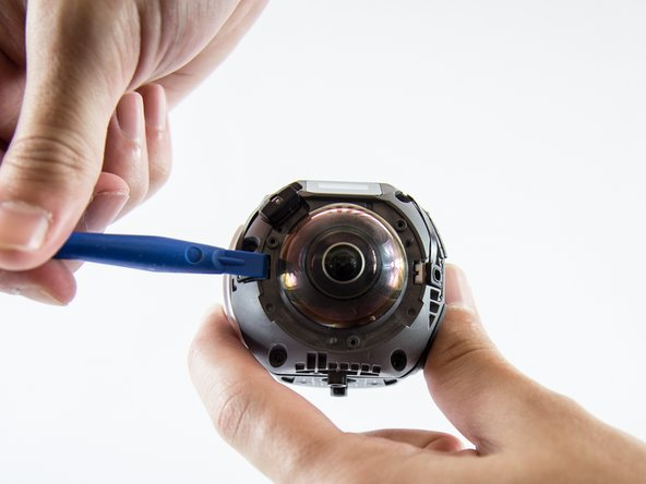 Carefully lift the three sensors off using a plastic opening tool and pull them aside.
