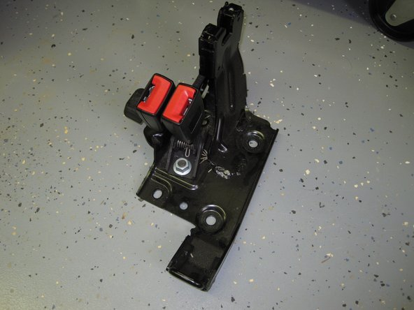 Image 3/3: When free, remove the bracket from the vehicle.