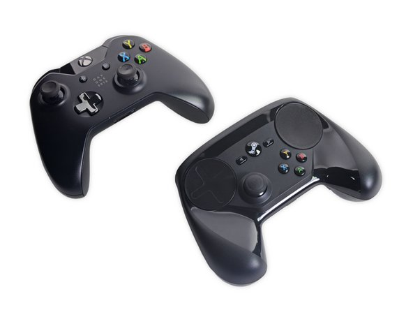 For comparison purposes: an Xbox One controller next to the Steam Controller.