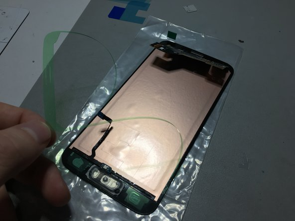 Prepare your screen assembly by removing adhesive film. If you're not replacing the screen then you can skip this step.