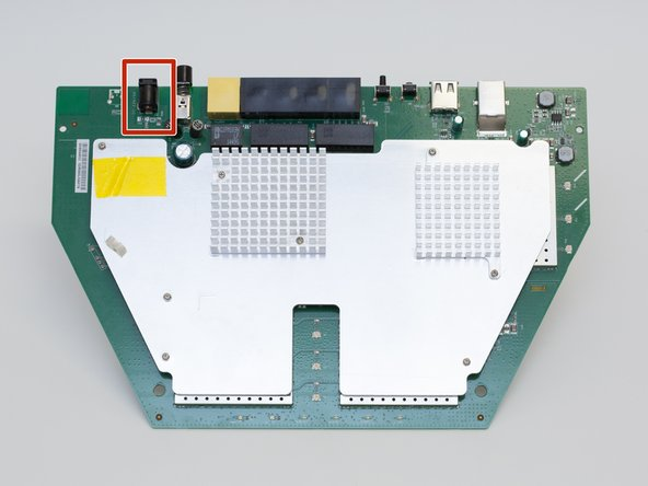 Locate the power adapter port at the top left of the motherboard.