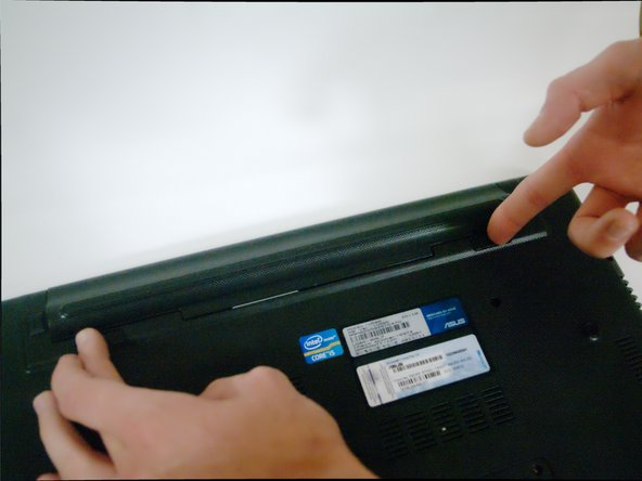 Make sure the laptop is unplugged before removing the battery to avoid risk of electric shock.