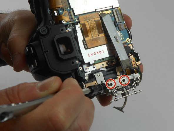 Remove the two 2.8 mm Phillips #PH00 black screws on the back of the swivel assembly using the PH00 screwdriver.