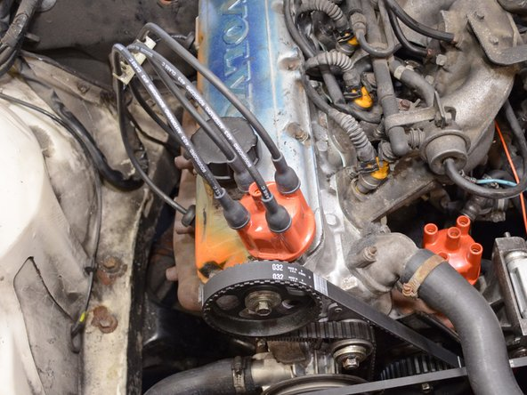 Image 3/3: Once all of the spark plug wires have been installed on the new distributor cap, set the cap aside.