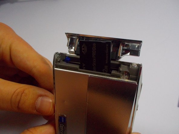 Push down on the SD card to pop it out, simply push the SD card back into the slot to re-insert it (image 2)