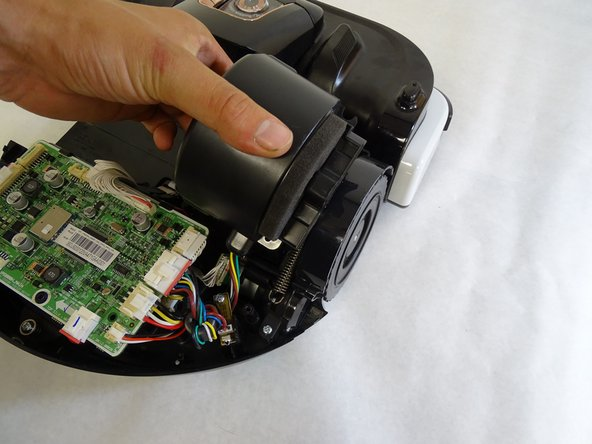 Lift the vacuum motor by grabbing the body of the motor and pulling upward.