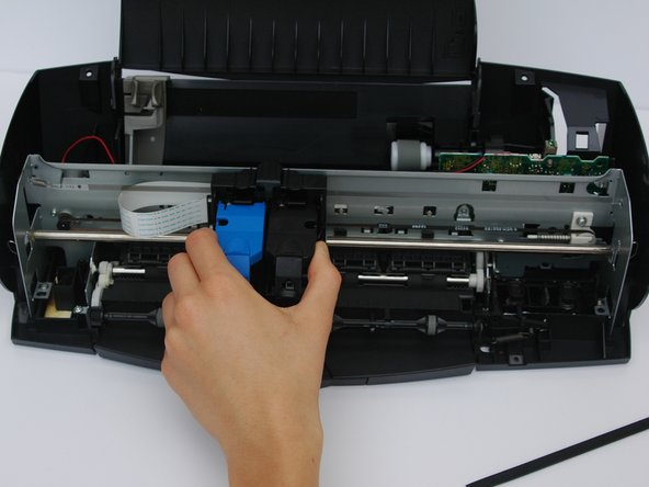 Slide the ink cartridge from the right side to the middle left so it is out of the way.