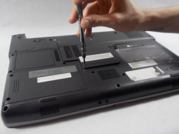 Remove the seven 6mm screws from the back panel with a Phillips #0 screwdriver.