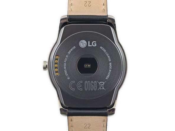 The rear of the watch features a heart rate sensor, charging dock contacts, and the model number (LG-W150).