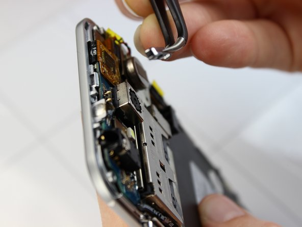 When replacing the power button align the flat side of the button to the silver edge of the display with the rounded edge facing the black frame.