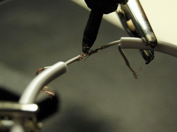 Image 1/2: When the soldering iron is hot, solder the wires together.