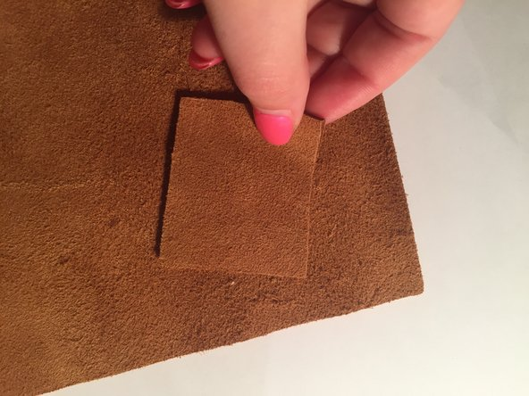 Michael's craft store has a wide  variety of genuine leather samples that you can choose from.