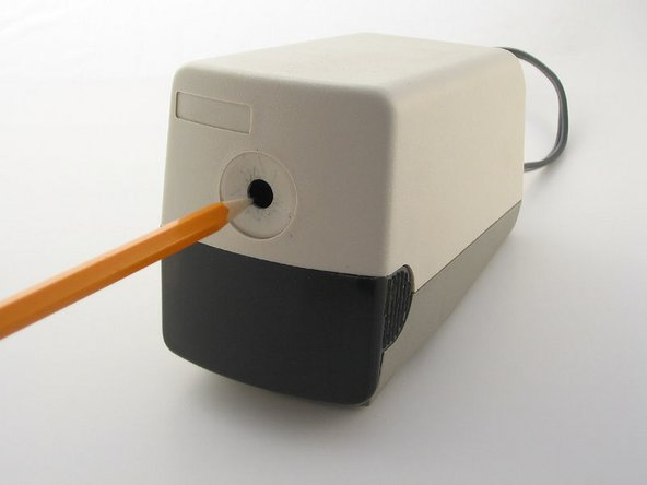 Remove the tray from the front of the pencil sharpener and empty the pencil shavings.