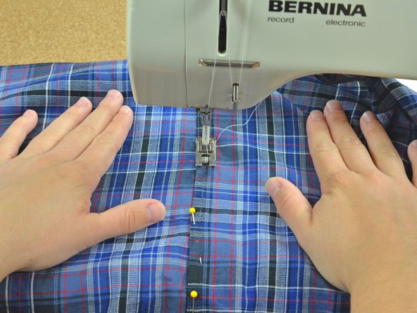 Image 1/3: Check your alignment and make sure the two edges of your fabric line up.