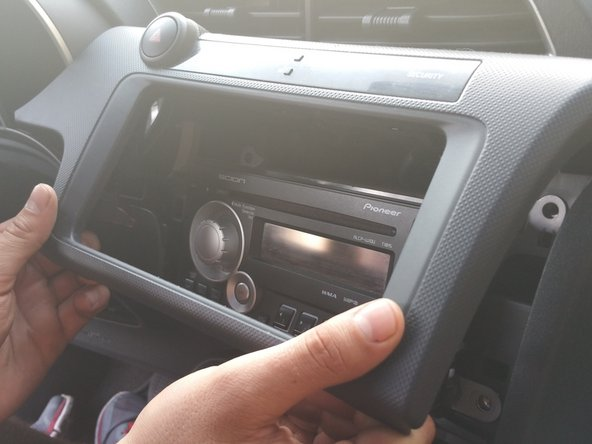 Remove the dashboard panel around the radio head by pulling on the bottom of the unit.