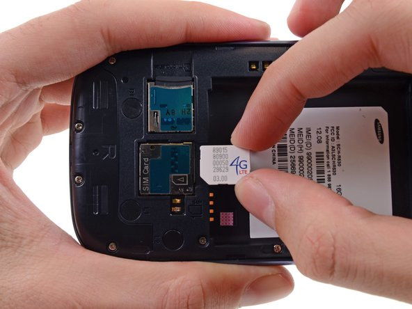 Image 3/3: Grasp and remove the SIM card away from the phone.