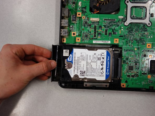 Slide the hard drive out away from the laptop until it is free from the motherboard