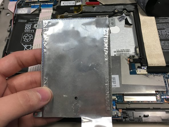The hard drive is no longer connected to the device. Lift the hard drive up vertically and set aside.