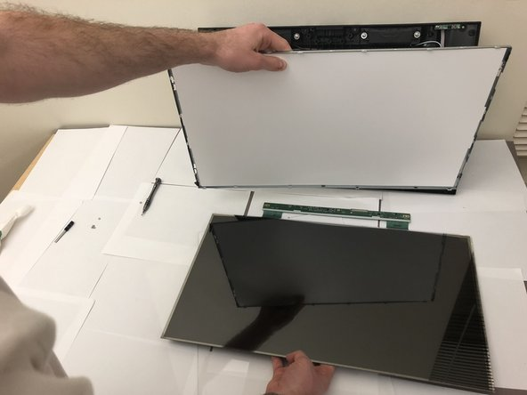 All cables connecting screen to frame are now detached. You are now ready to pull apart and separate the screen.