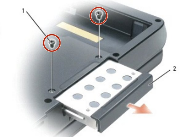 Turn over the computer and remove the two M3 x 3 - mm screws.