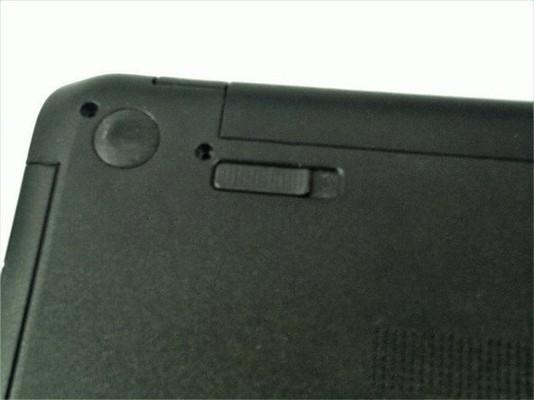 Firmly slide the release latch to unlock the battery and slide the battery release latch to release the battery.