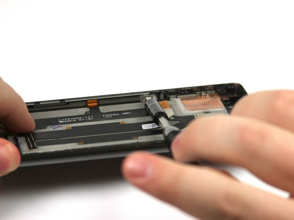 Remove the three 3mm screws with a T5 screwdriver along the side of the device where the volume buttons are.