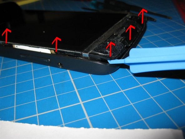Use a combination of plastic pry and fingernails to work round the edge to lift it.