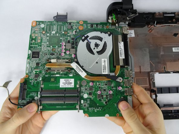 Flip the motherboard over.