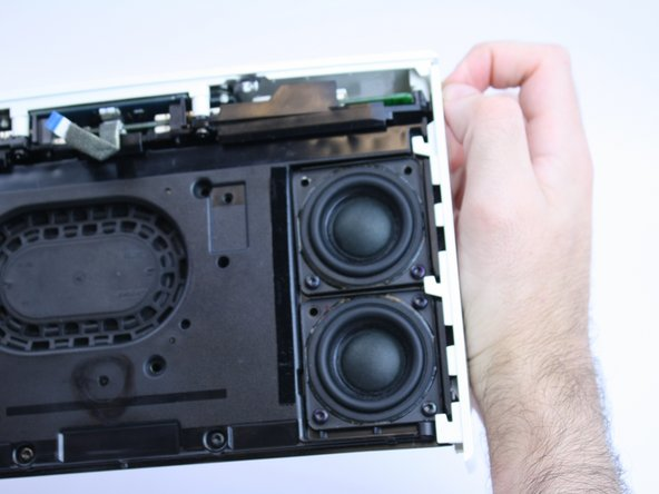 With the bottom of the device facing you, pull down the trim pieces to remove from the device body.
